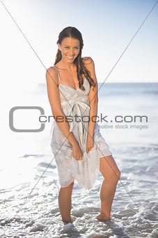 Smiling brunette posing on the beach