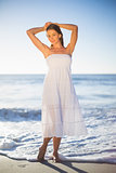 Beautiful woman in white summer dress posing