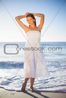 Beautiful woman in white summer dress posing