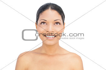 Smiling black haired woman posing