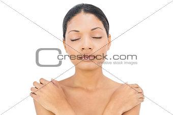 Sleepy black haired woman posing