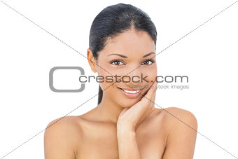 Smiling black haired model posing