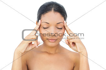 Black haired model having a headache