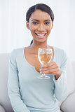 Cheerful attractive woman drinking white wine