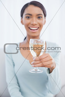 Smiling attractive woman drinking white wine