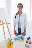Smiling pretty artist posing