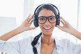 Cheerful attractive artist listening to music