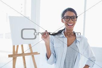Smiling attractive artist posing