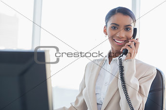 Smiling gorgeous businesswoman on the phone