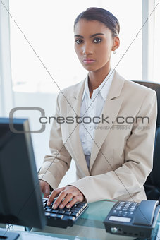 Serious businesswoman working on her computer