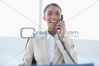Smiling elegant businesswoman on the phone