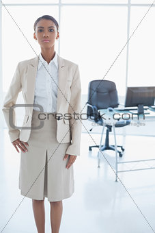 Unsmiling elegant businesswoman posing