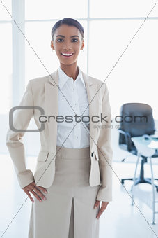 Cheerful elegant businesswoman posing