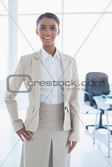 Cheerful elegant businesswoman posing