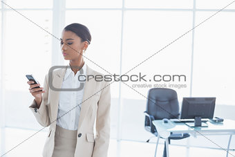 Cheerful elegant businesswoman text messaging