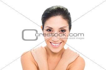 Smiling brunette with her hands on shoulders