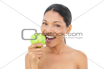 Smiling black haired model holding green apple