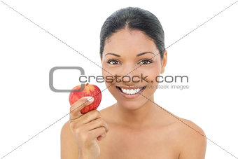 Smiling black haired model holding red apple