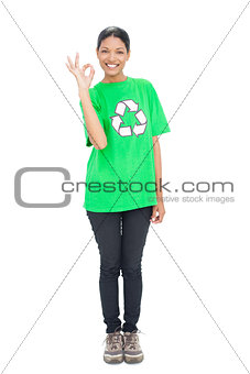 Black haired model wearing recycling tshirt making okay gesture