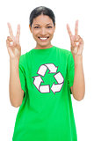 Happy model wearing recycling tshirt making peaceful gesture