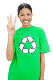 Happy model wearing recycling tshirt showing three fingers