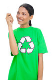 Cheerful model wearing recycling tshirt holding light bulb