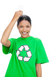 Smiling model wearing recycling tshirt holding light bulb above her head