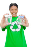 Smiling model wearing recycling tshirt holding pots