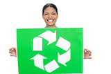 Smiling model holding recycling sign