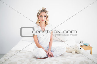 Gorgeous blonde sitting on cosy bed