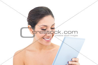 Attractive brunette using a digital tablet