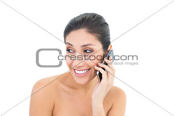 Attractive brunette making a call on smartphone