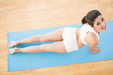 Fit woman stretching in cobra pose