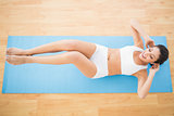 Fit woman doing abdominal crunches