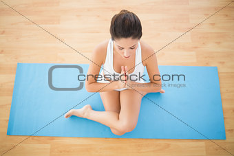 Fit woman sitting in cow face pose