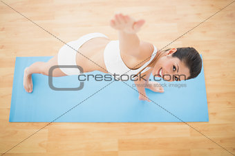 Fit woman stretching in extended side angle pose