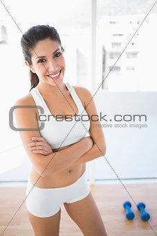 Fit woman smiling at camera