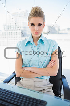 Serious classy businesswoman crossing arms