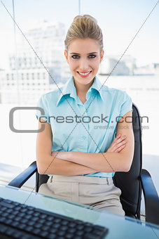 Happy classy businesswoman crossing arms