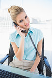 Smiling stylish businesswoman answering the phone