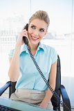 Cheerful stylish businesswoman answering the phone