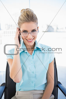 Smiling businesswoman wearing glasses having a call