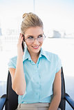 Cheerful businesswoman wearing glasses having a call