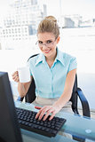 Smiling elegant businesswoman holding coffee while working
