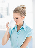 Peaceful elegant woman drinking coffee