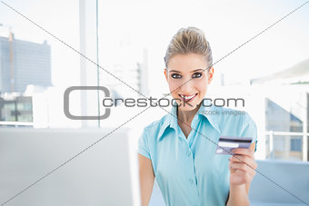Smiling elegant woman shopping online