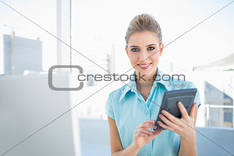 Smiling elegant woman using calculator
