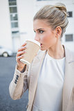 Relaxed stylish businesswoman drinking coffee