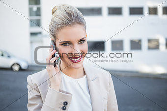 Cheerful stylish businesswoman having a phone call