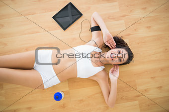 Fit smiling woman doing sit ups